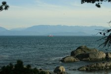Juan de Fuca Strait and the Olympic Mountains in the background.""
