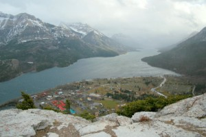 Look down below on the town of Waterton, Alberta and down the valley into Montana.